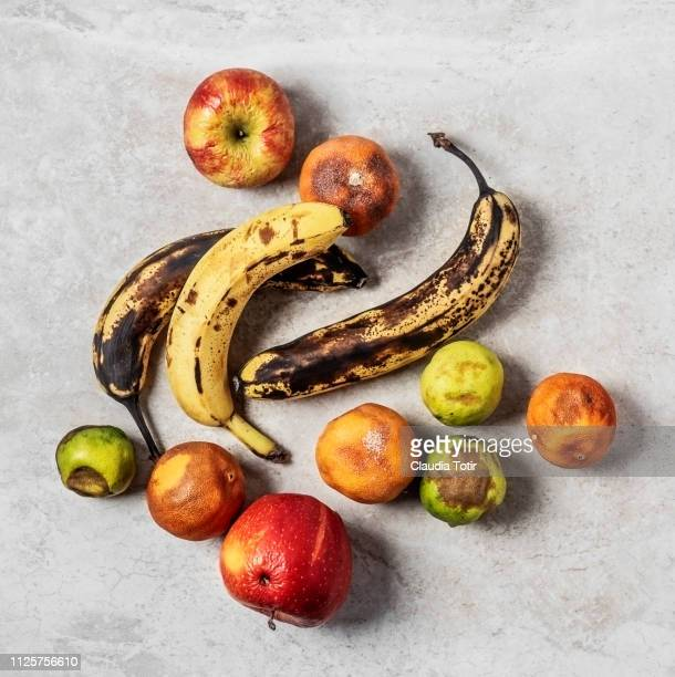 spoiled, rotten fruits - leftovers stock pictures, royalty-free photos & images