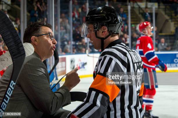 Spokane Chiefs' head coach Dan Lambert stands on the bench and speaks to referee Jeff Ingram against the Kelowna Rockets at Prospera Place on March...