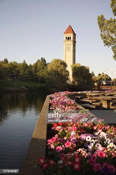 spokane clock tower with petunias - spokane stock pictures, royalty-free photos & images