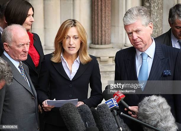 Spokes person Katharine Witty reads a statement from Mohamed Al Fayed as Michael Cole looks on outside the High Court on April 7 2008 in London The...
