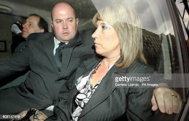 spokesman Chris Johnson Stuart Fergus and Denise Fergus the mother of James Bulger leave the Old Bailey in central London following Jon Venables's...