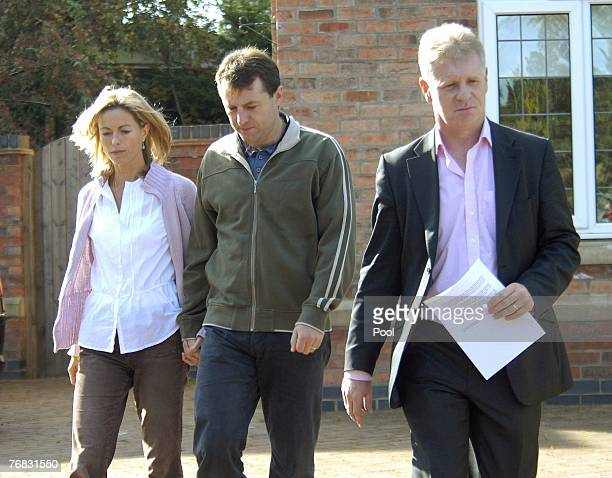 Spokesman Clarence Mitchell a former BBC journalist makes his way along with Kate and Gerry McCann to give a statement to the press September 18 2007...