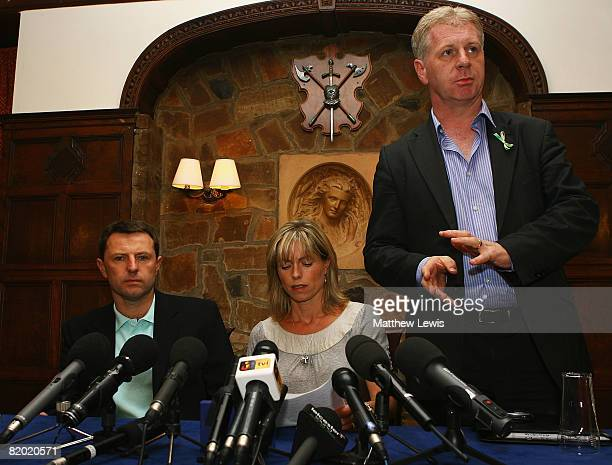 Spokesman Clarence Mitchell addresses the media beside Kate and Gerry McCann as they start a press conference to anounce that they have been cleared...