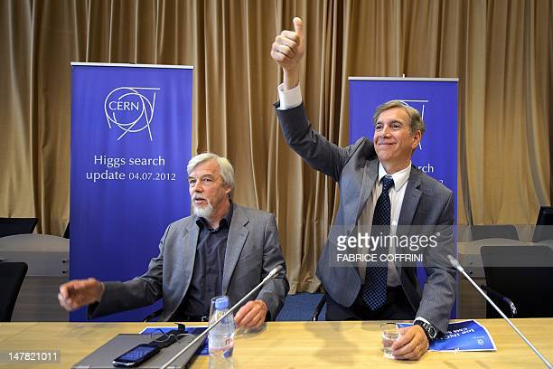 Spokesman for CMS Joe Incandela gestures next to CERN DirectorGeneral RolfDieter Heuer at a press conference on July 4 2012 at CERN offices in Meyrin...