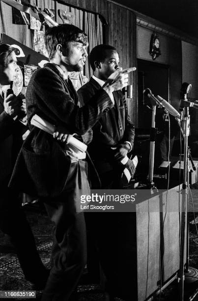 Spokesman for the American Deserters Committee Bill Jones , along with unidentified others, speaks during a press conference at the annual meeting of...