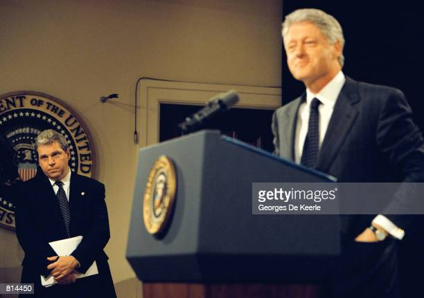 Spokesman Joe Lockhart listens as President Clinton answers a question during a press conference at the White House June 25 1999