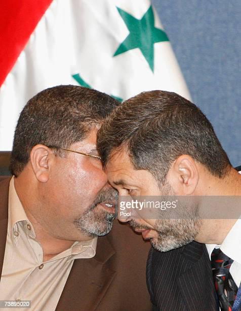Spokesman of AlSadr parliamentary bloc Nassar AlRubai speakis with unidentified member of AlSadr bloc during press conference April 16 2007 in...