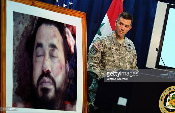 Spokesman of MultiNational ForceIraq Major General Bill Caldwell speaks during a press conference as a picture of the killed leader of alQaeda in...