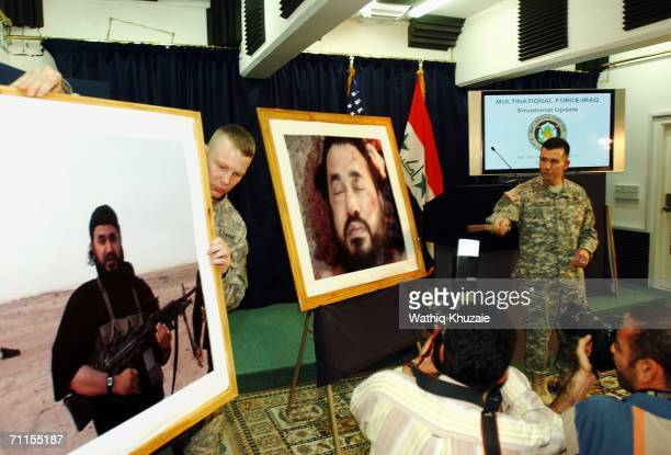 Spokesman of MultiNational ForceIraq Major General Bill Caldwell speaks during a press conference next to a picture of the killed leader of alQaeda...