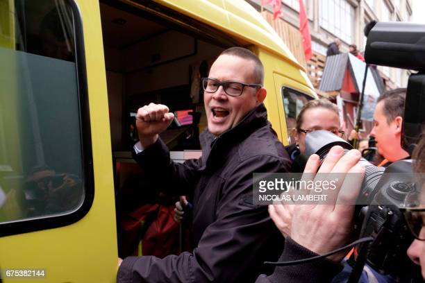 PVDA PTB spokesman Raoul Hedebouw steps into an ambulance after being attacked by knife during a May Day rally in Liege on May 1 2017 Hedebouw...