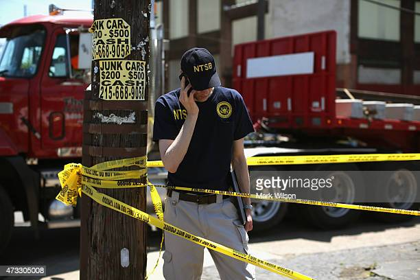 NTSB spokesmen Peter Knudson talks on his phone near Tueday's Amtrak train derailment May 14 2015 in Philadelphia Pennsylvania Today rescue workers...