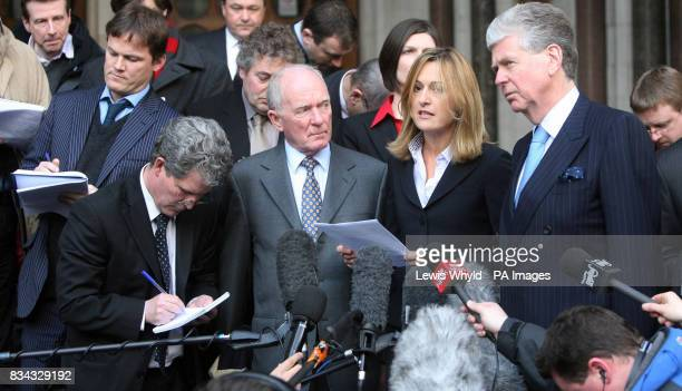 Spokesperson for Mohamed AlFayed Katharine Witty reads a statement outside the High Court in central London today as AlFayed's assistant Michael Cole...