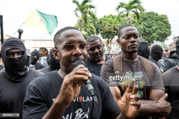 Spokesperson of the 500 brothers collective Mikael Mancee and Zadkiel Saint Orice joins protesters in front of the Prefecture on April 7 in Cayenne,...