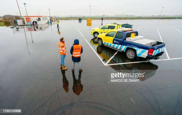 Spokesperson wears a safety vest during a press tour of an overflow parking lot for trucks after the Brexit transition period, in Hook of Holland,...