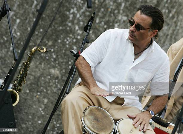 US actor Andy Garcia is pictured during a sound check with The Cineson AllStars at Teatro Romano 30 June 2007 in Spoleto for the 50th edition of...