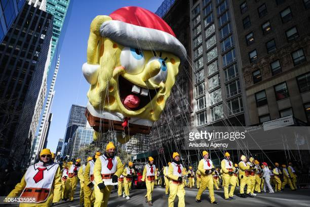 Sponge Bob balloon floats above the crowd during the Macy's Thanksgiving Day Parade on November 22, 2018 in New York City, United States.
