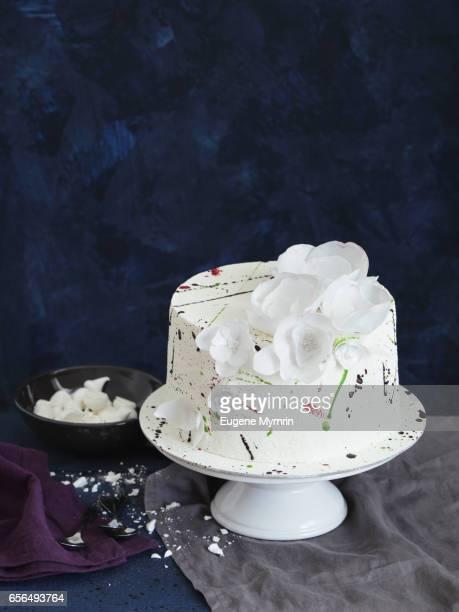 Sponge cake decorated with waffle flowers