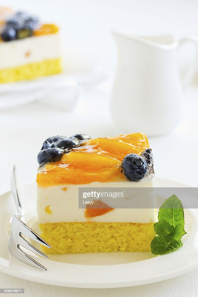 Sponge cake with yogurt mousse, apricots and blueberries. : Stock Photo
