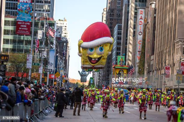 SpongeBob balloon floats over Sixth Avenue during the 91st annual Macy's Thanksgiving Day Parade on November 23 2017 in New York City