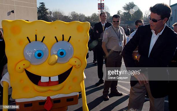 SpongeBob SquarePants and Hall of Fame pitcher Jim Palmer celebrate the opening of the 4000th Walgreen store