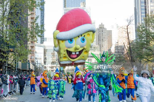SpongeBob SquarePants giant balloon floats at 92nd Annual Macy's Thanksgiving Day Parade on the streets of Manhattan in frigid weather