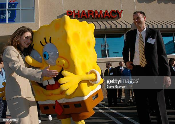 SpongeBob SquarePants greets Walgreens executives at the grand opening of their 4000th store