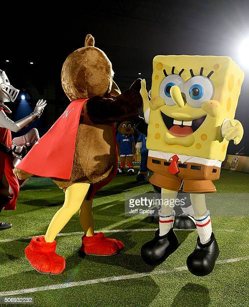 Spongebob Squarepants high fives Robyn the Robin mascot of Charlton Athletic as 15 mascots from The Football League take part in a Guinness World...