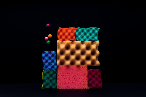 Sponges piled up with marbles levitating around. - gettyimageskorea