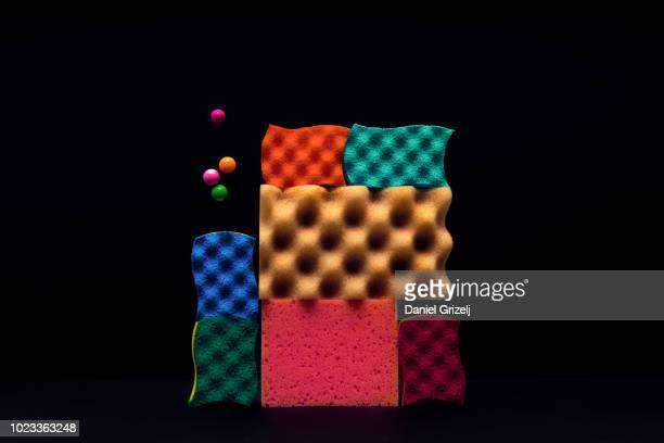 sponges piled up with marbles levitating around. - patchwork stock pictures, royalty-free photos & images