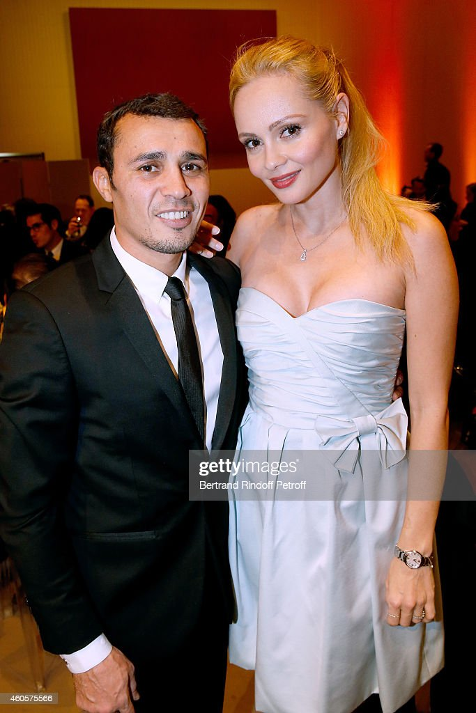Sponsors of the event, Boxer Brahim Asloum and actress Beatrice Rosen attends the 'Fondation Claude Pompidou' : Charity Party at Fondation Louis Vuitton on December 16, 2014 in Paris, France.