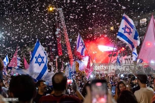 Spontaneous celebrations take place in Rabin Square after the confidence vote on June 13, 2021 in Tel Aviv, Israel. The new government, a broad...