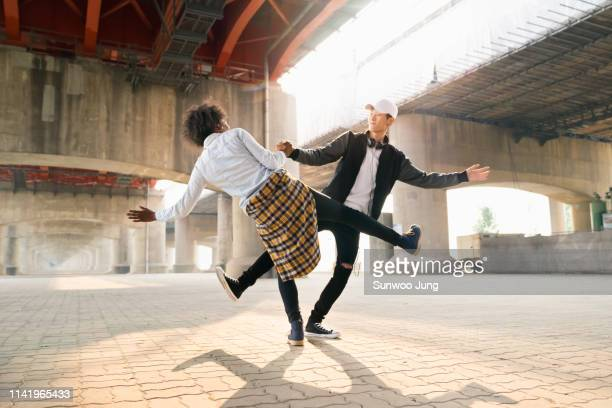spontaneous dancing - asian cheerleaders stock photos and pictures