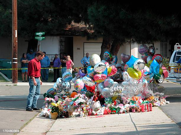 Spontaneous memorial at the crime scene Marcus Wesson suspect mass murder Fresno California