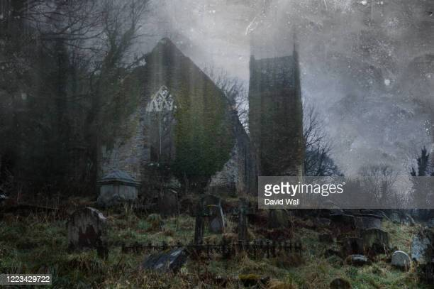 a spooky, abandoned graveyard with a ruined church in the background. with a vintage, grunge edit. - church stock pictures, royalty-free photos & images