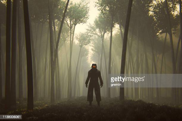 spooky apocalypse warrior in the forest at night - evil stock pictures, royalty-free photos & images