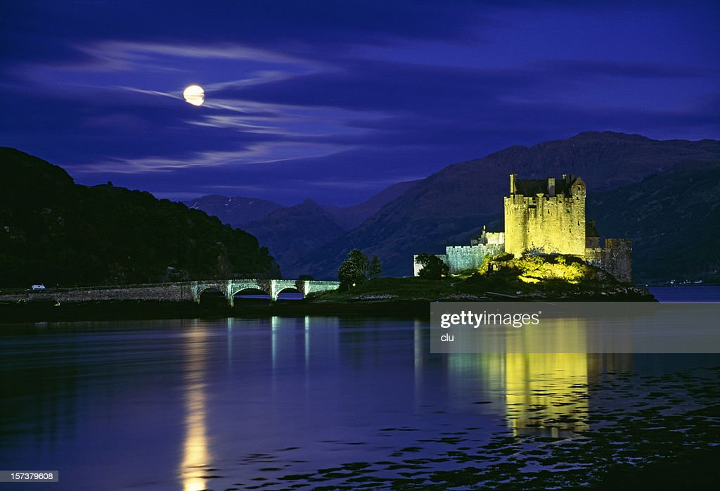 Spooky castle with moon : Stock Photo