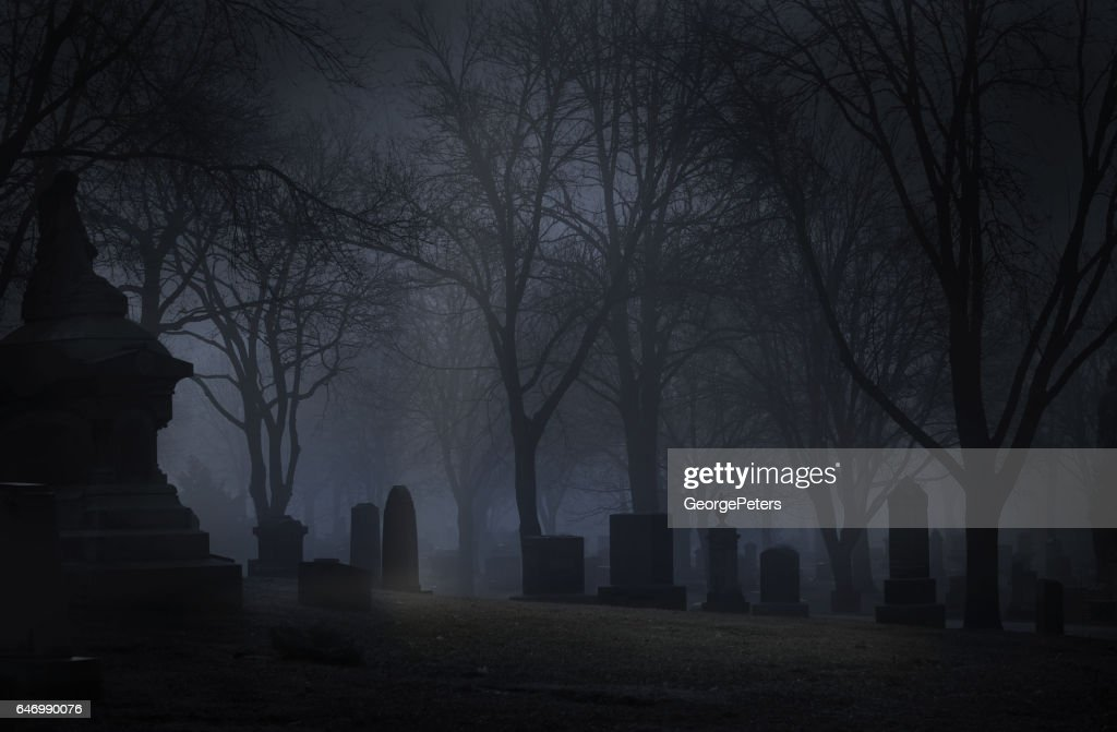 Spooky Cemetery at night with fog : Stock Photo