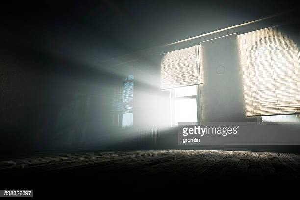 spooky empty room with mysterious light beams - oude ruïne stockfoto's en -beelden