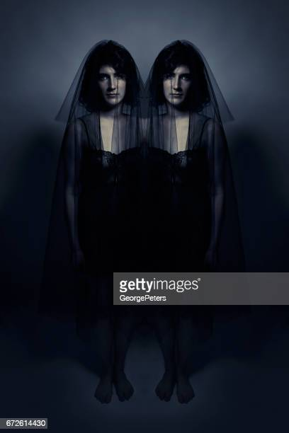 spooky identical twins in black veils - conjoined twin stock photos and pictures