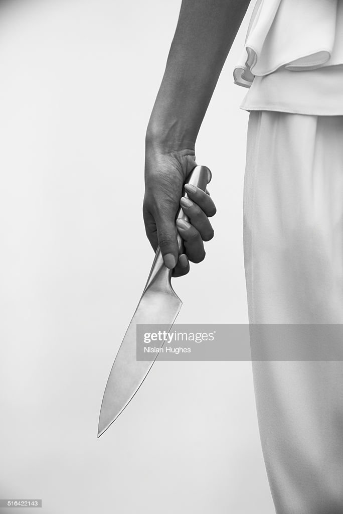 Spooky image of knife and woman's hand : Stock Photo