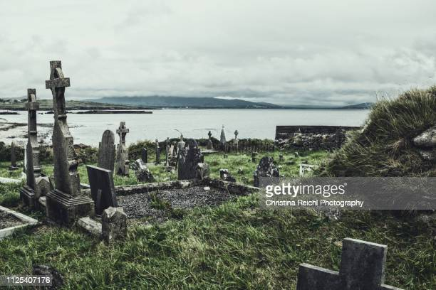 spooky irish graveyard - cemetery stock photos and pictures