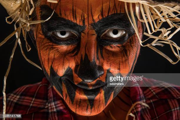 spooky jack o'lantern scarecrow halloween make up - scarecrow agricultural equipment stock photos and pictures