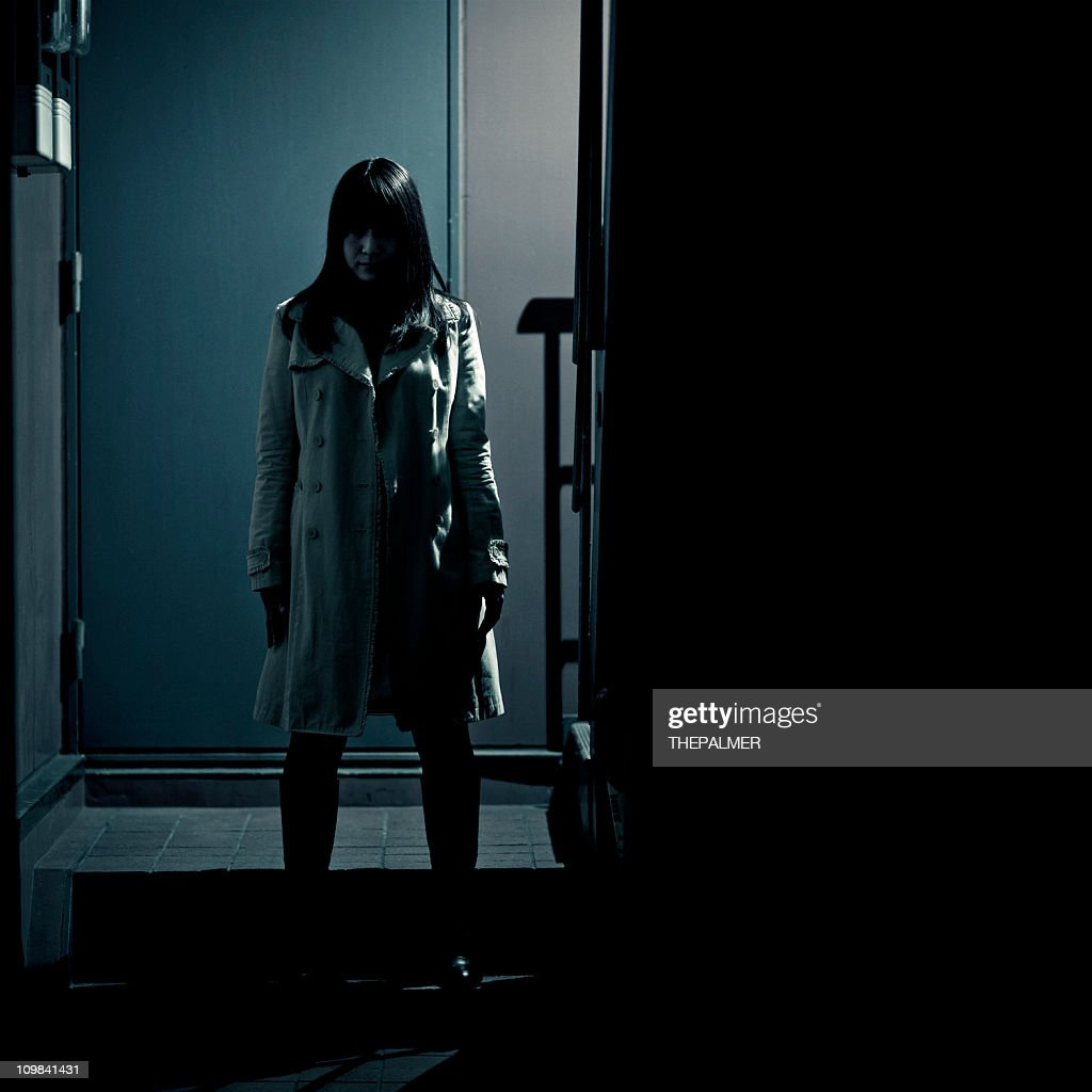 spooky japanese girl at the entrance of building : Stock Photo
