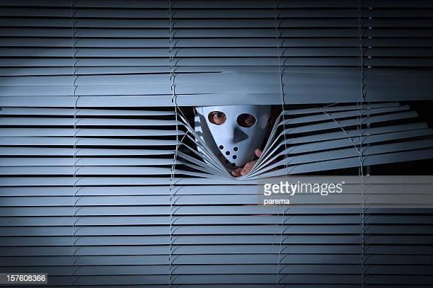 Spooky men behind blinds