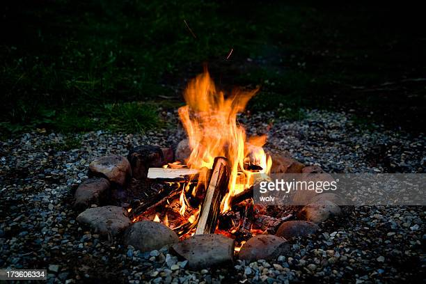 spooky orange campfire at night - camp fire stock photos and pictures