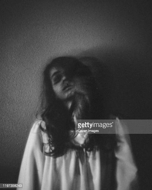 spooky portrait of ghost girl standing against wall - goose bumps stock pictures, royalty-free photos & images