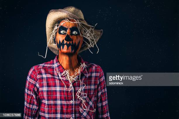 spooky pumpkin head scarecrow halloween costume - scarecrow faces stock photos and pictures