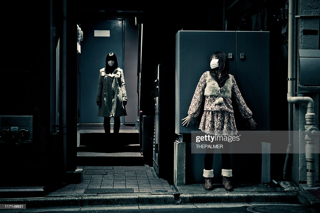spooky scene in tokyo with two girls : Stock Photo