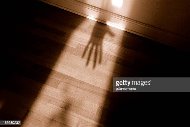 spooky shadow - domestic violence stock pictures, royalty-free photos & images