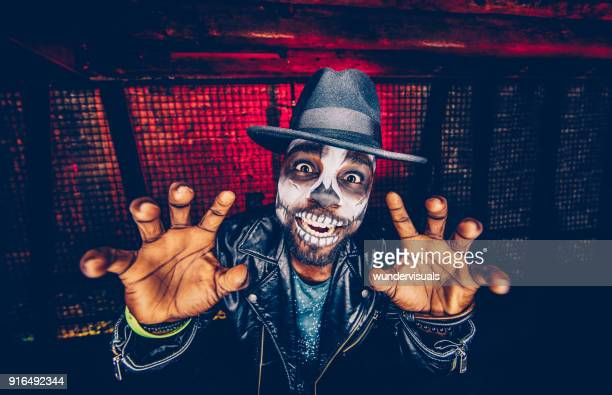 spooky skeleton man having fun celebrating halloween - halloween party stock photos and pictures